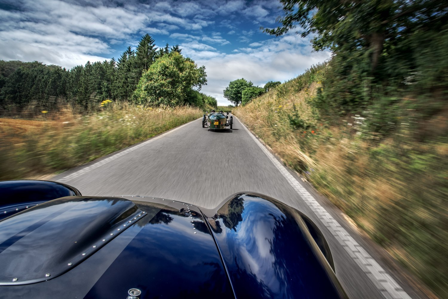 A Cobra chasing a Morgan 3-wheeler