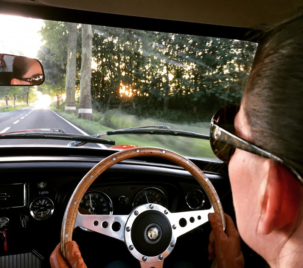 Marie driving MGB